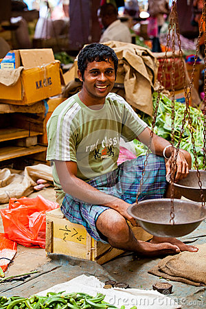 Seller on local market in Sri Lanka - April 2, 2014