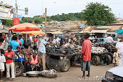 Selling fish and shoes on African street market Editorial Image