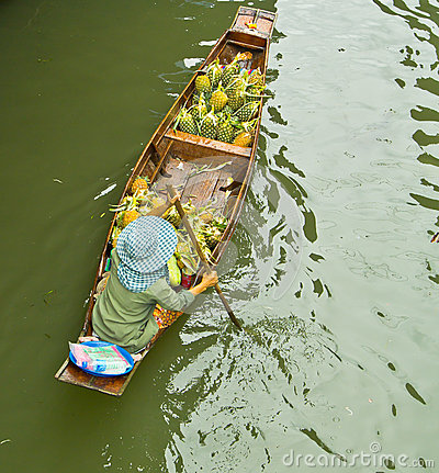 Selling food on a boat at floating market, Thailand