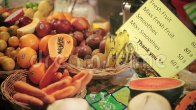 Selling fruit at the market in Thailand. Pickled fruits is Street foods of Thailand. Market for shopping local product and foods stock footage