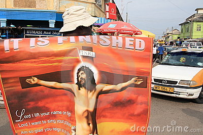 Selling Jesus posters on African street Editorial Photography