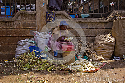 Selling maize at a market Editorial Stock Image