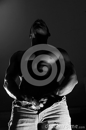 Semi nude muscular man in jeans