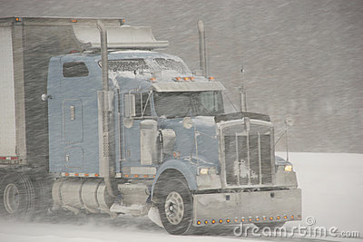 Semi-Truck driving in a blizzard