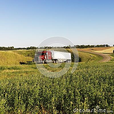 Semi truck on rural road.