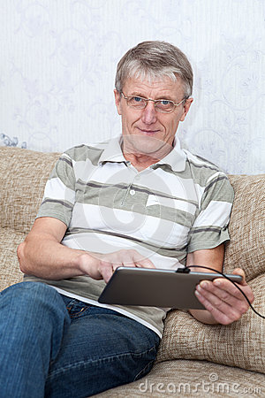 Senior adult man working with new tablet computer