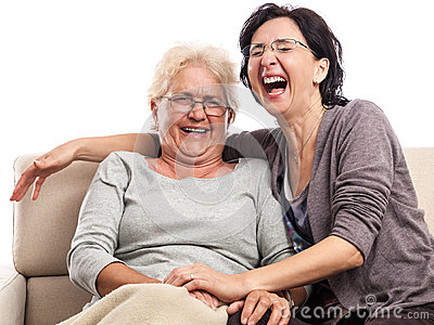 Senior adult two women laughing portrait