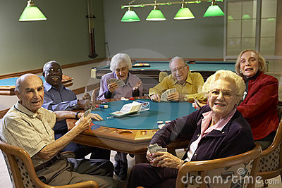 Senior adults playing bridge