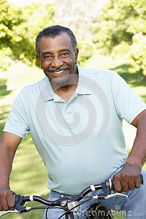 Free Senior African American Man Cycling In Park Stock Photography - 54961722