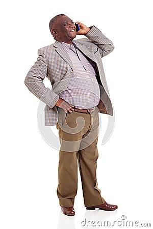 Senior african man talking cell phone