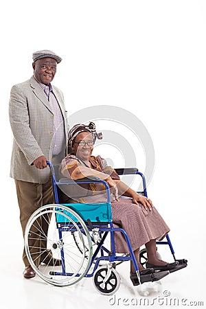 Senior african man wife wheelchair
