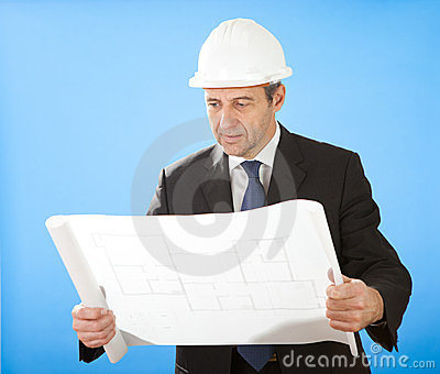Senior architect holding blueprints on sky