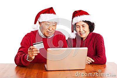 Senior Asian couple shopping online