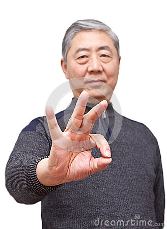 Senior asian man showing finger