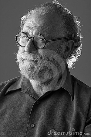 Senior bearded man looks watchful