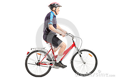 A senior bicyclist ridng a bicycle