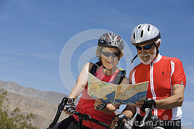 Senior Bicyclists Reading Map Together