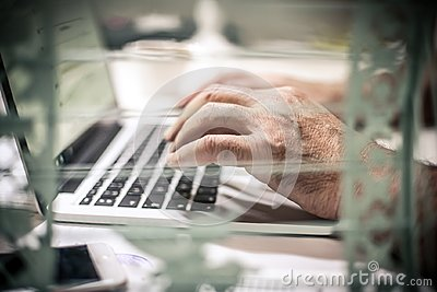 Typing on laptop. Close up. Stock Photo