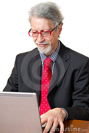 Senior business man with pc