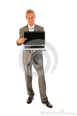 Senior business man pointing to laptop