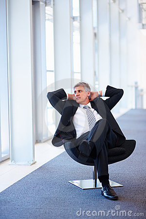 Senior business man relaxing on a chair