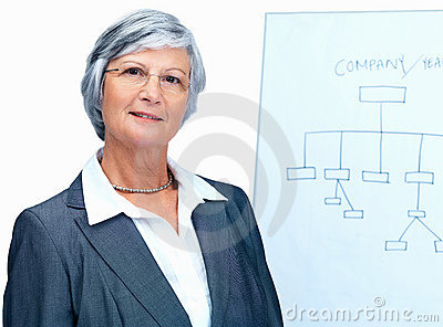 Senior business woman with a flipchart at the back