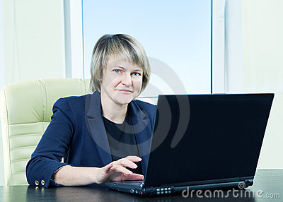 Senior business woman in office interior