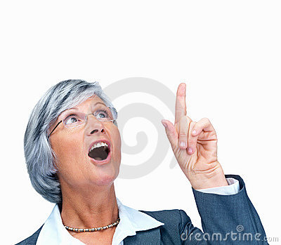 Senior business woman pointing upwards in surprise