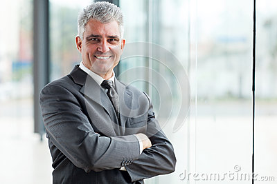 Senior businessman arms crossed