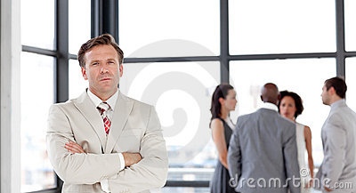 Senior Businessman with Business team