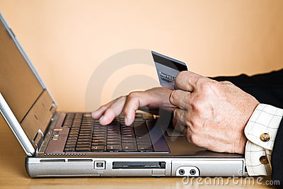 Senior businessman buying online