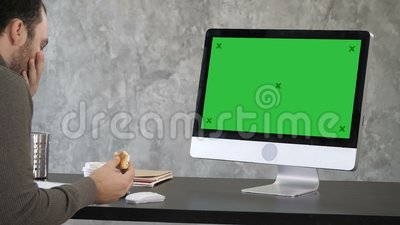 Senior businessman choking in front of his computer. Green Screen Mock-up Display. View to the screen of computer. Senior businessman choking in front of his stock video