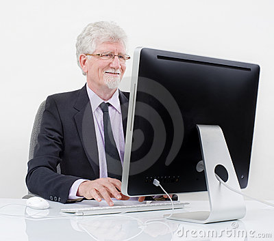 Senior businessman with computer
