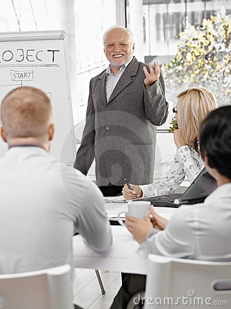 Senior businessman doing presentation