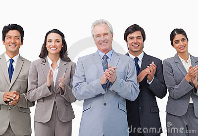 Senior businessman and his team applauding