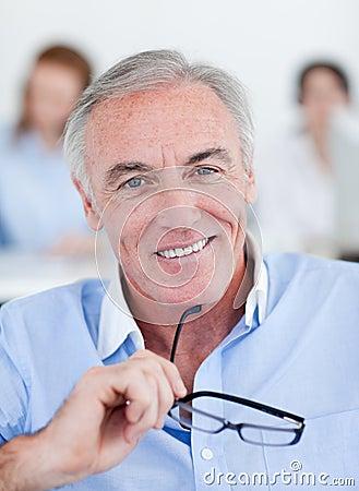 Senior businessman holding glasses