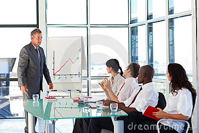 Senior businessman interacting with his team
