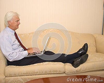 Senior Businessman on Laptop