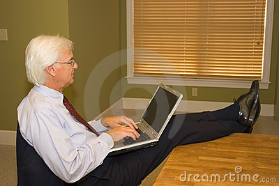 Senior Businessman on Laptop
