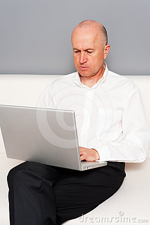 Senior businessman with laptop