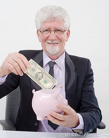 Senior businessman and piggybank