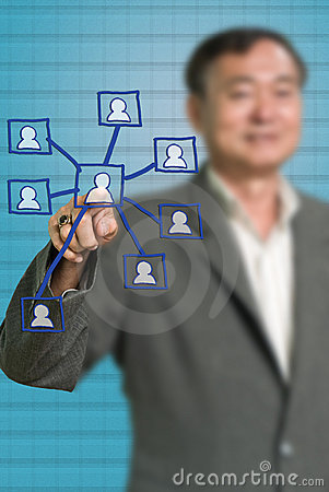 Senior businessman push the social network icon