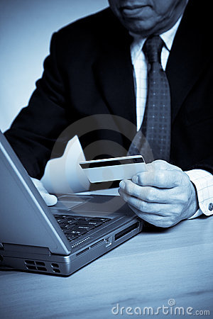 Senior businessman shopping online