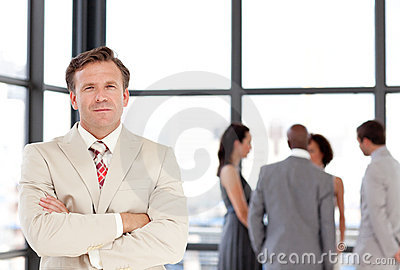 Senior Businessman standing Business team