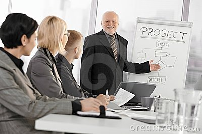 Senior businessman training colleagues