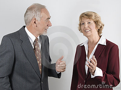 Senior businessman and woman in discussion