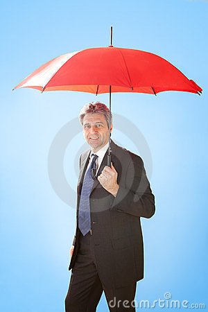 Senior businessmen holding a umbrella