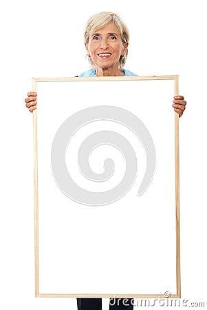 Senior businesswoman holding placard