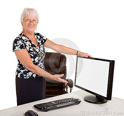 Senior Businesswoman Pointing a Monitor