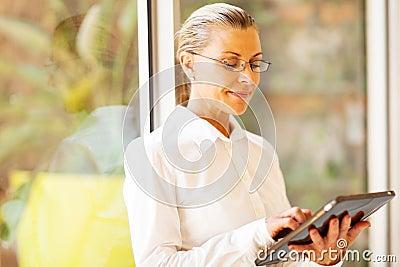 Senior businesswoman tablet computer